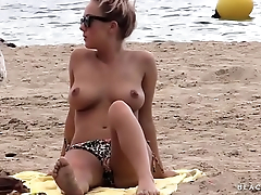 Amazing topless babe with perfect big natural tits caught on beach