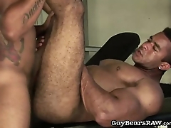 Muscled men fuck in gym